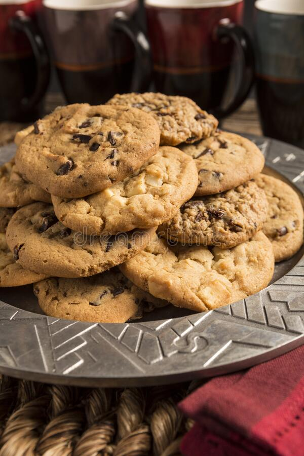 Free Closeup Of A Group Of Assorted Flavored Cookies. Chocolate Chip, Macadamia Nut, Oatmeal Raisin, On A Silver Plate With Coffee Cups Royalty Free Stock Photography - 182780657