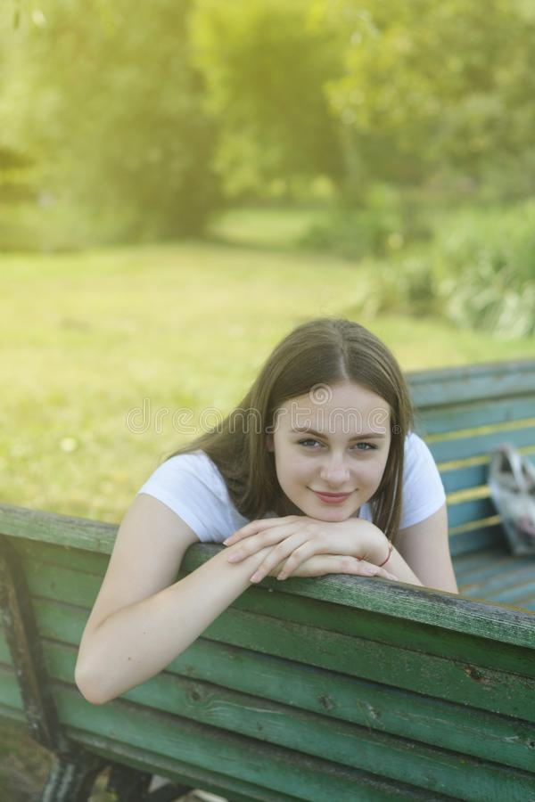 Free Closeup Of Teenage Girl Sitting, Relaxing In The Park, On A Bench. Education, School Girl. Smiling Young Woman. Summer Time, Stock Images - 156078124