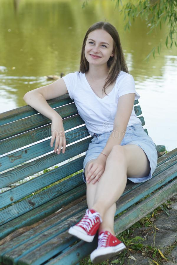 Free Closeup Of Teenage Girl Sitting, Relaxing In The Park, On A Bench. Education, School Girl. Smiling Young Woman. Summer Time, Stock Images - 156078224