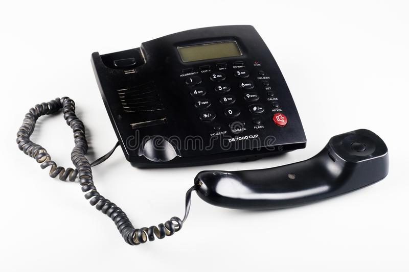 Closeup of an Off the hook black landline phone royalty free stock image
