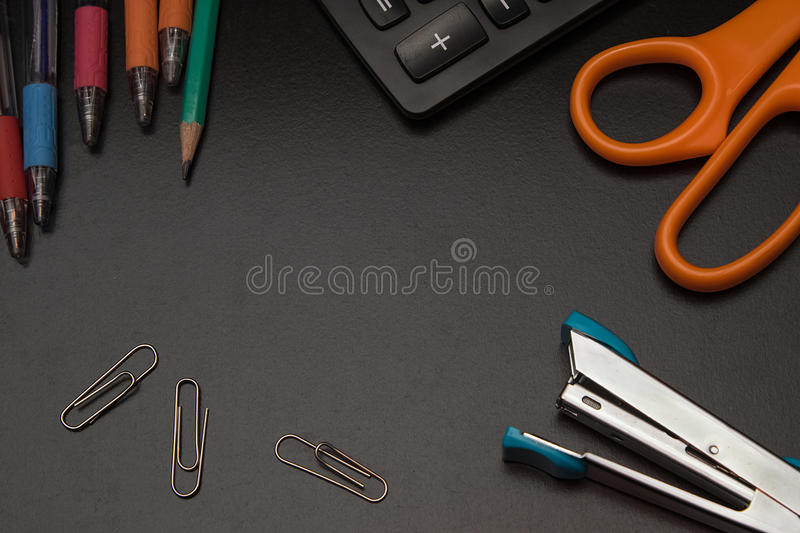 Closeup office stationery on black background. Back to shcool concept royalty free stock photo