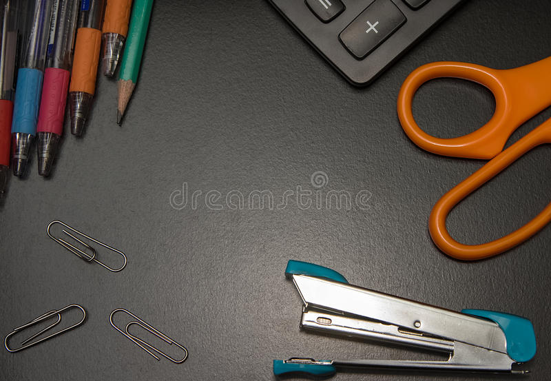 Closeup office stationery on black background. Back to shcool concept royalty free stock image