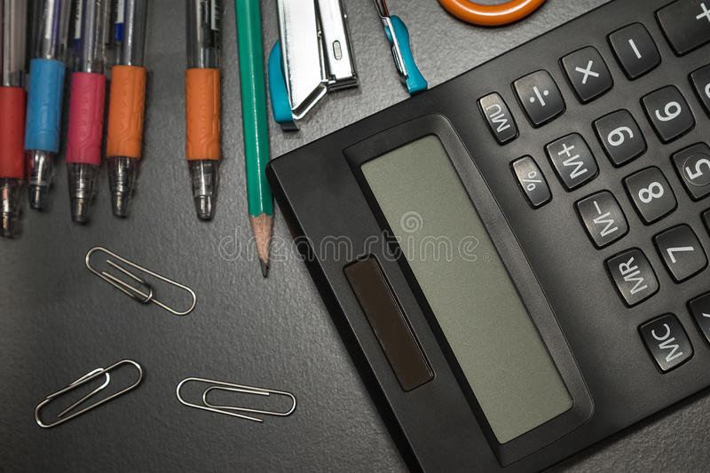 Closeup office stationery on black background. Back to shcool concept stock images