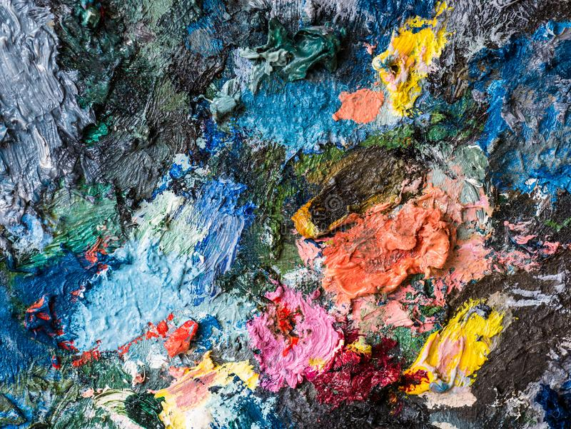 Closeup of oil color on palette of artist stock image
