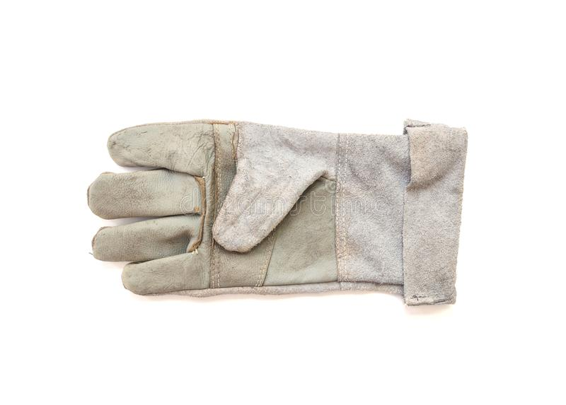 Closeup old fabric glove for construction worker isolated on white background. Old fabric glove for construction worker isolated on white background stock images