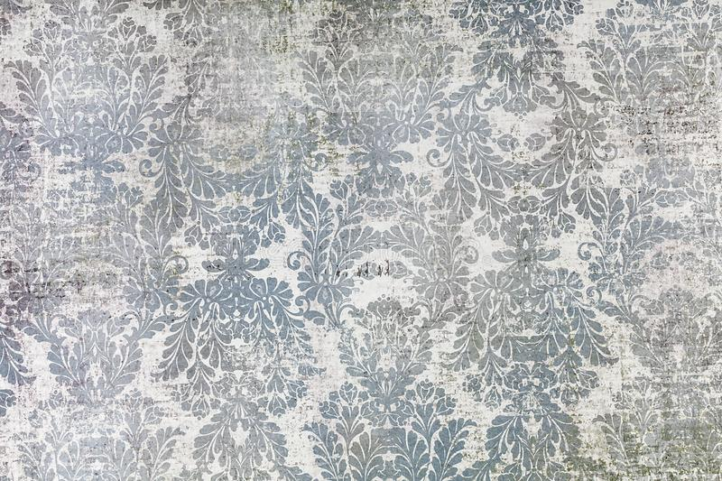 Traditional old fashioned shabby paper pattern. A closeup of an old fashioned shabby repeating leaf pattern printed on paper background stock photography