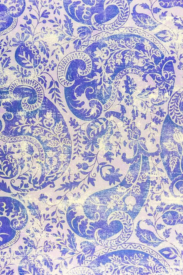 Traditional old fashioned shabby paper pattern. A closeup of an old fashioned shabby repeating paisley patter printed on paper background royalty free stock photography