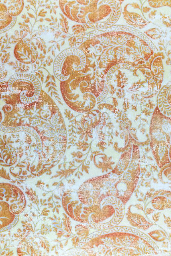 Traditional old fashioned shabby paper pattern. A closeup of an old fashioned shabby repeating paisley patter printed on paper background royalty free stock image