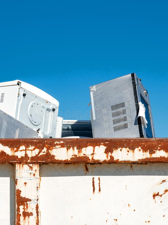 Old household appliances stored in a waste container stock photography
