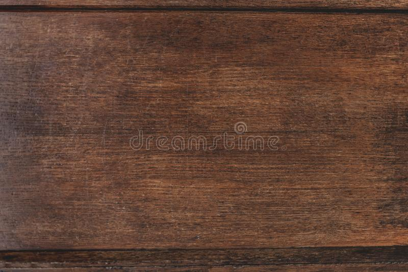 Closeup of old natural wood grunge texture. Dark surface with old natural wooden pattern. Vintage wooden floor. Rustic table top. View with copy space for text stock photos