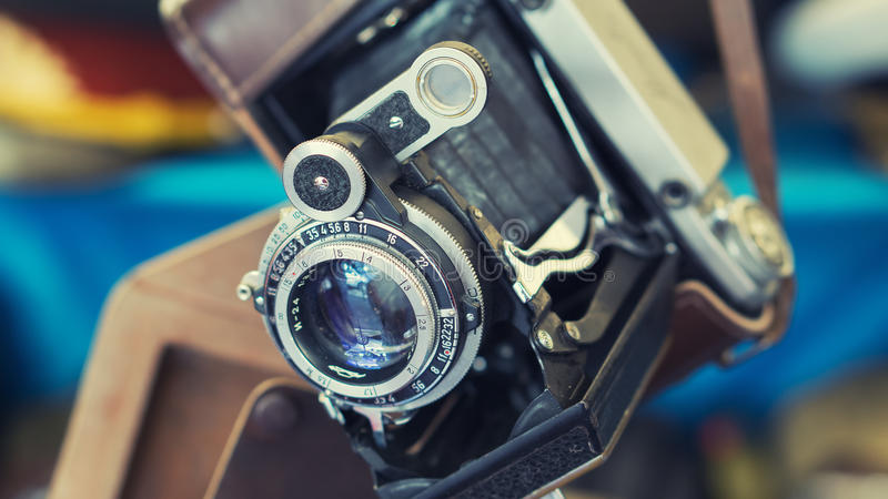 Closeup of old retro vintage film photo camera with lens stock images