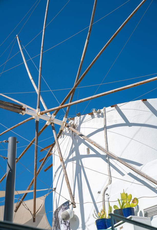 Closeup of old windmill with sails removed with shadows cast randomly over structure stock photography