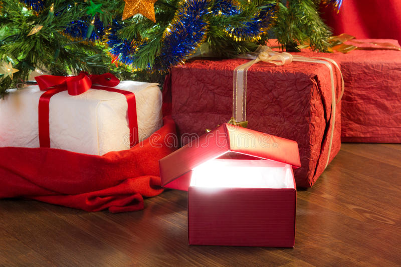 Closeup open red gift with green christmas tree royalty free stock image