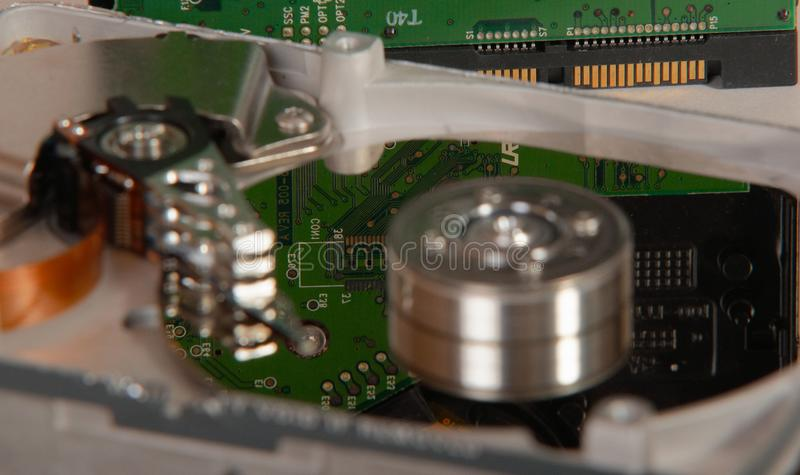 A closeup of an opened computer harddrive stock photography
