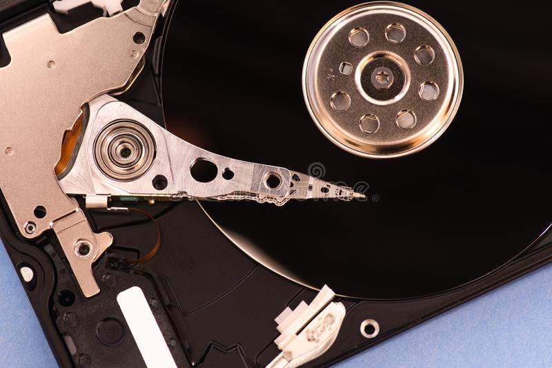 Closeup opened disassembled hard drive from the computer, hdd with mirror effect stock image