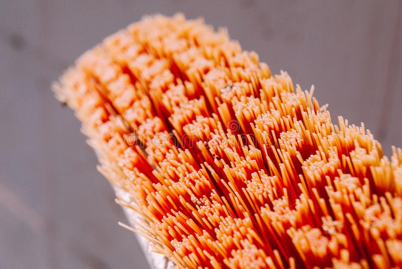 Closeup orange old cleaning brush bristle royalty free stock photography