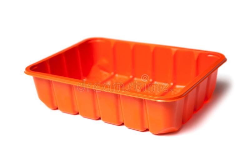 Orange plastic box for microwave food on white background stock image