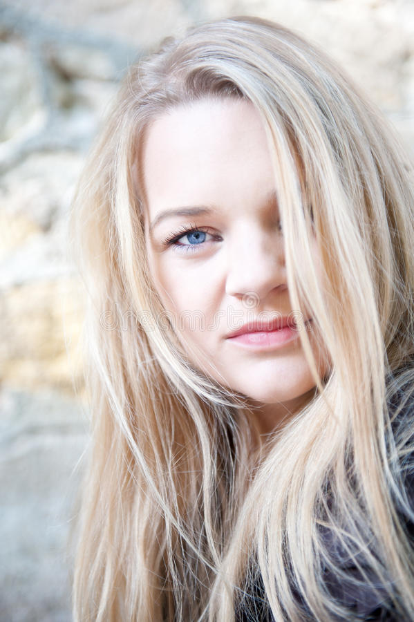 Closeup outdoor portrait of a young woman stock images