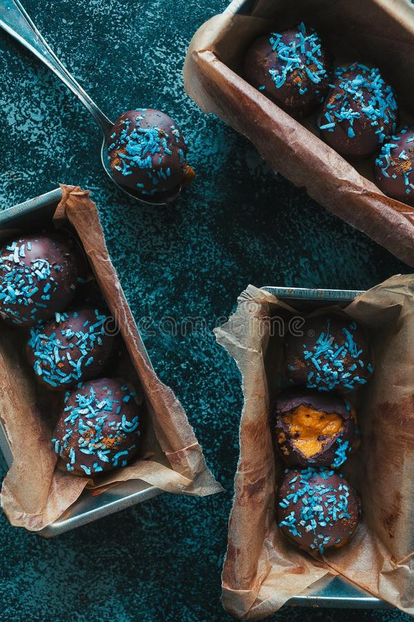Closeup overhead shot of chocolate balls with blue glitter or sparkle on them in boxes royalty free stock photo