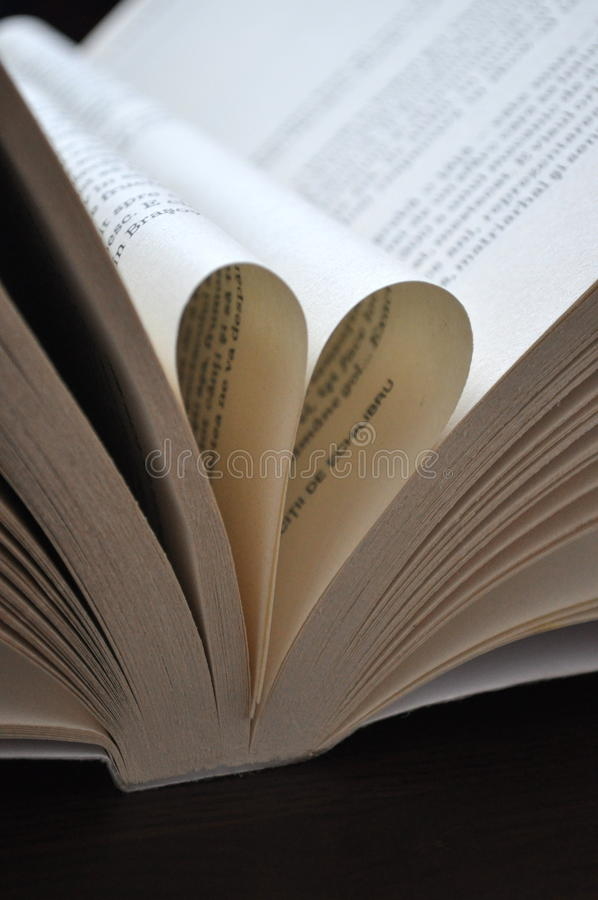 Closeup pages of an open book, with heart shaped pages stock photo