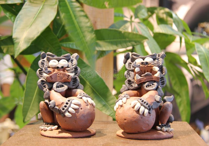 The guardian Shisa lion dogs , Okinawa, Japan. Closeup a pair of clay Okinawan lion dogs, also called shisa Shisa is a traditional Ryukyuan decoration from stock images