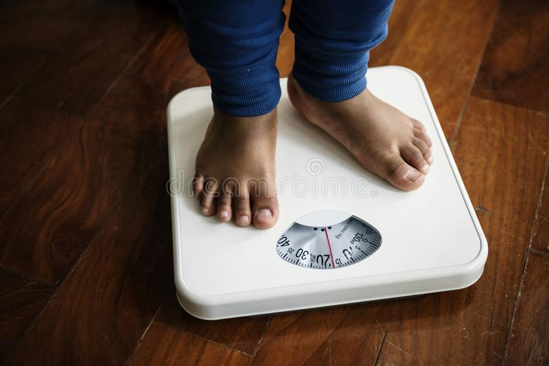 Closeup of a pair of leg measuring on weigh scale stock photos