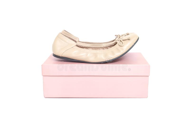 Closeup brown woman shoes on pink paper box of shoes isolated on white background stock images