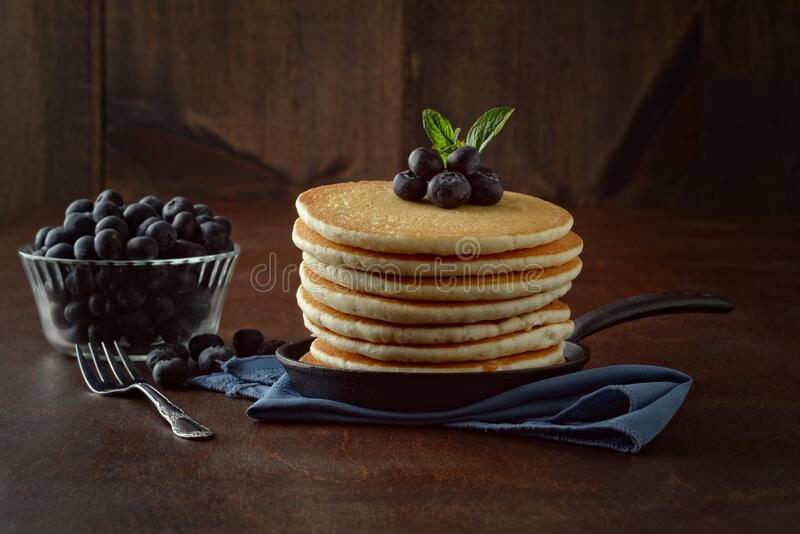 Pancakes with fresh blueberries royalty free stock photo