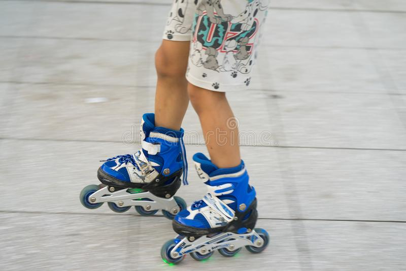 Closeup panning children roller skating. Learning to skate outdoor.  royalty free stock photo