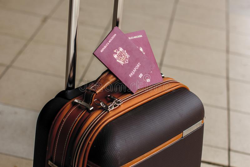 Closeup of passports on the luggage. Travel or emigration concept. Biometric passport of Moldova stock images