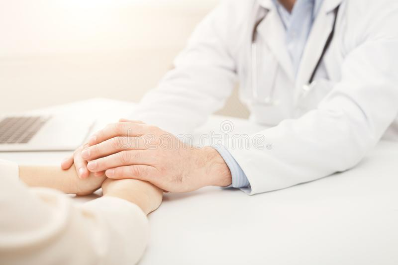Closeup of patient and doctor hands royalty free stock photos