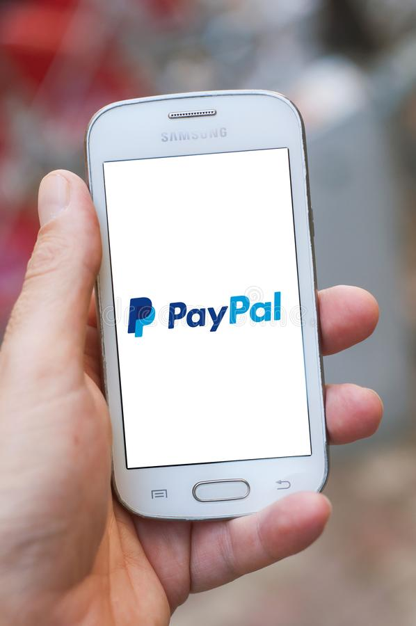 Closeup of paypal logo on smartphone screen in hand from Samsung brand in the street. Mulhouse - France - 4 September 2019 - Closeup of paypal logo on smartphone royalty free stock images