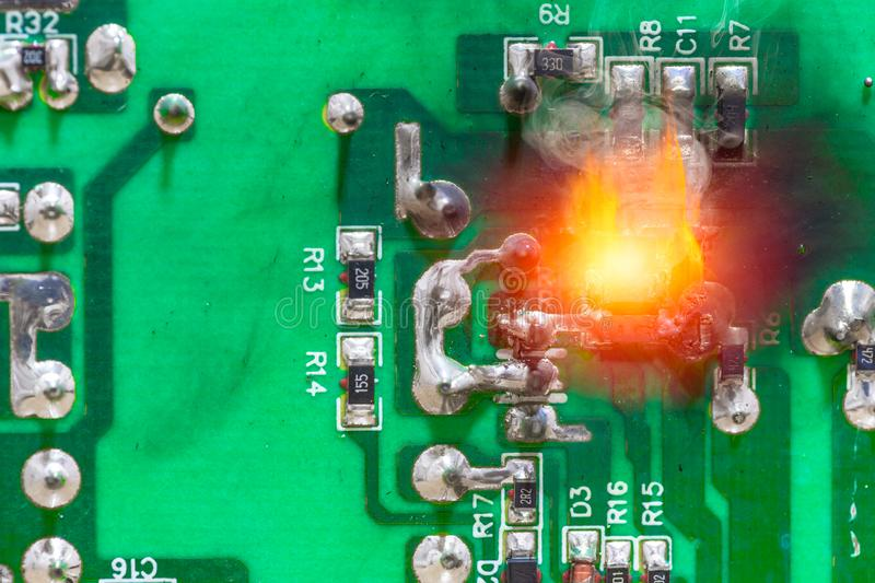 PCB circuit board electricity short circuit fire and burning stock images