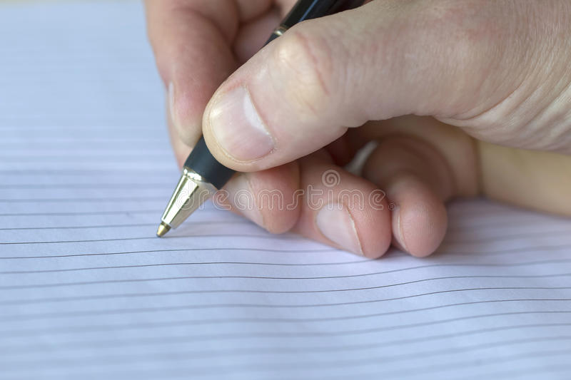 Closeup of a pencil on a writing pad royalty free stock photography
