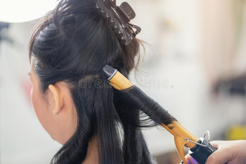 Closeup people hairdresser coiffeur makes hairstyle at haircut shop, Hair care in modern spa salon stock image