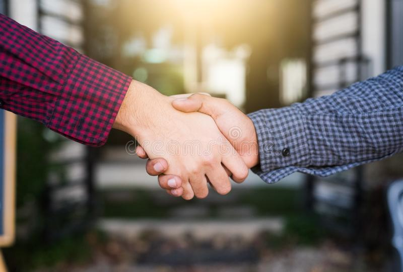Closeup of people shaking hands royalty free stock image