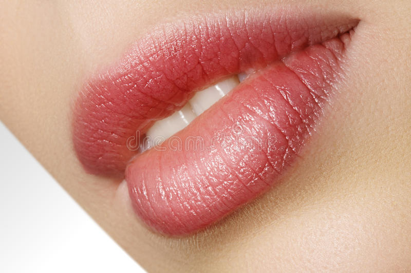 Closeup perfect natural lip makeup. Beautiful plump full lips on female face. Clean skin, fresh make-up. Spa tender lips. Close-up perfect natural lip makeup royalty free stock photos