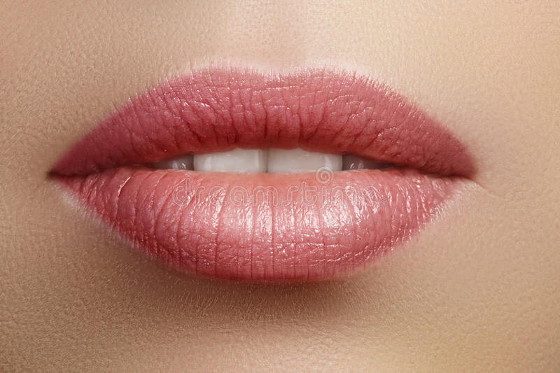 Closeup perfect natural lip makeup. Beautiful plump full lips on female face. Clean skin, fresh make-up. Spa tender lips. Close-up perfect natural lip makeup stock image