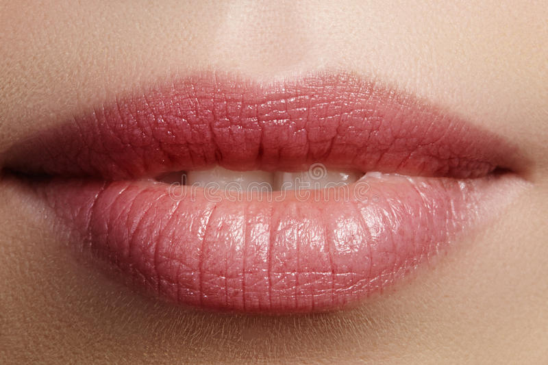 Closeup perfect natural lip makeup. Beautiful plump full lips on female face. Clean skin, fresh make-up. Spa tender lips. Close-up perfect natural lip makeup stock images