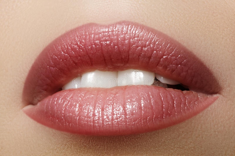 Closeup perfect natural lip makeup. Beautiful plump full lips on female face. Clean skin, fresh make-up. Spa tender lips. Close-up perfect natural lip makeup royalty free stock images