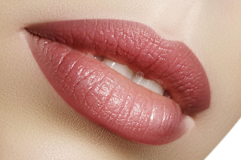 Closeup perfect natural lip makeup. Beautiful plump full lips on female face. Clean skin, fresh make-up. Spa tender lips. Close-up perfect natural lip makeup stock photos