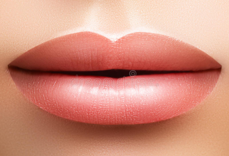 Closeup perfect natural lip makeup. Beautiful plump full lips on female face. Clean skin, fresh make-up. Spa tender lips. Close-up perfect natural lip makeup royalty free stock photography
