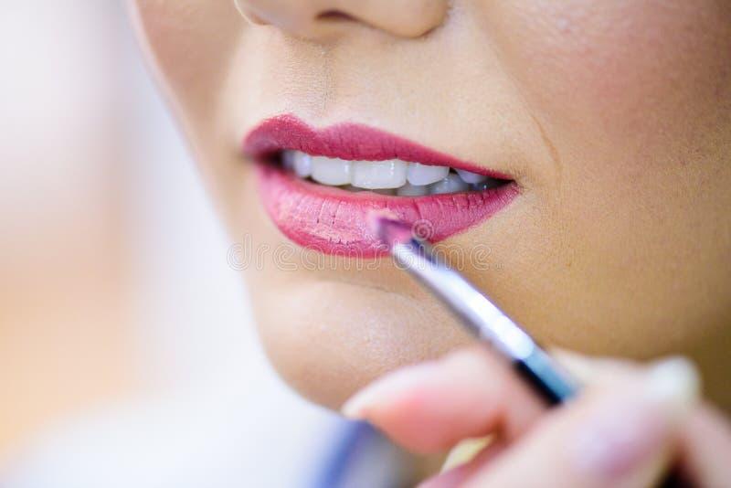 Closeup perfect natural lip makeup.Clean skin, fresh make-up. Spa tender lips. Augmentation, glamour. stock image