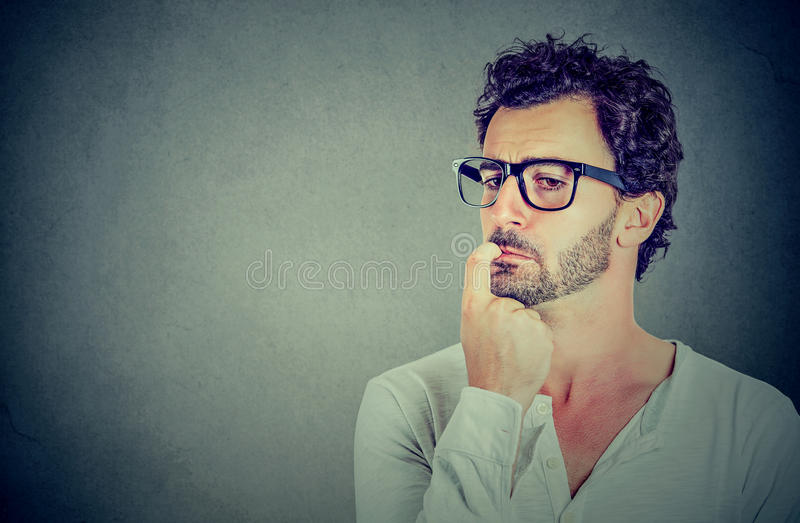 Closeup perplexed preoccupied young man stock photo