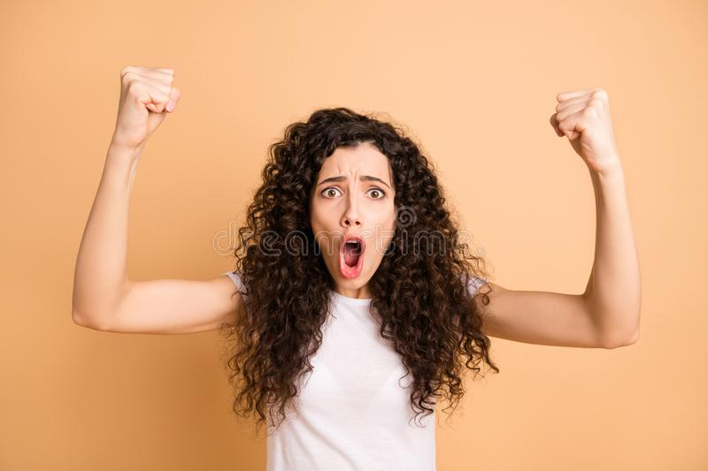 Closeup photo of amazing wavy lady raising hands fists crazy screaming football team supporting wear white casual outfit. Closeup photo of amazing wavy lady royalty free stock image