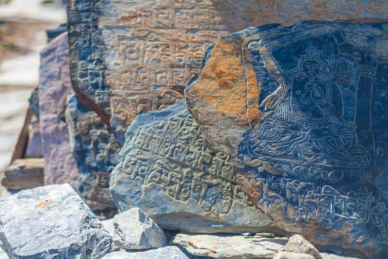 Closeup Photo Autentic Draw Stone Buddist Symbols and Mantras. Horizontal. Nepal Travel Trakking. Closeup Photo Autentic Draw Stone Buddist Symbols and Mantras stock photo