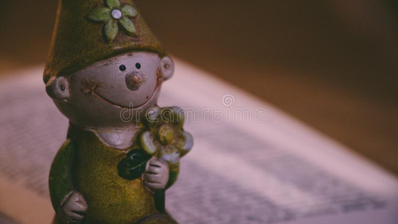 Closeup Photo of Boy Holding Flower Figurine royaltyfria bilder