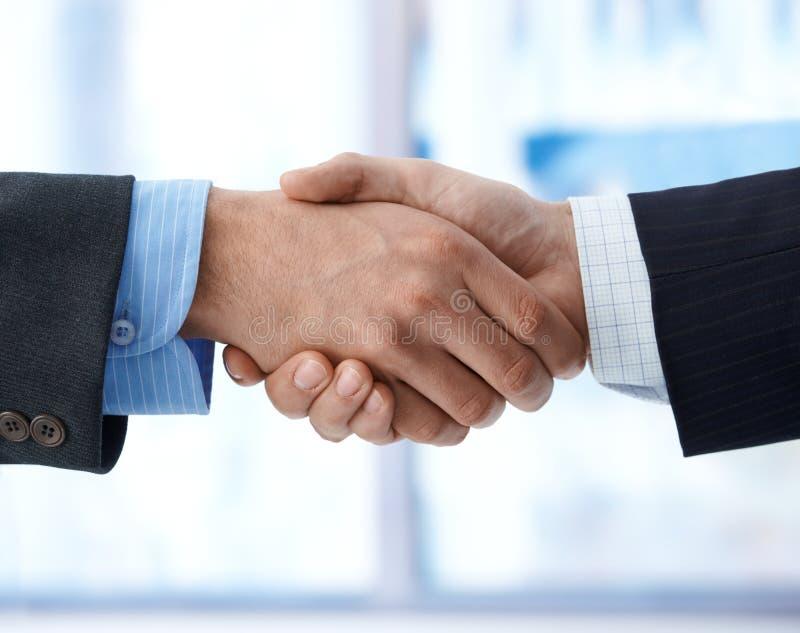 Closeup photo of business handshake stock images