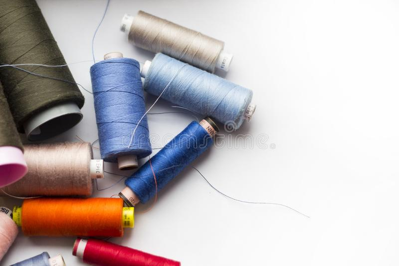 A bunch of sewing thread reels. A closeup photo of colorful sewing thread reels stock photography