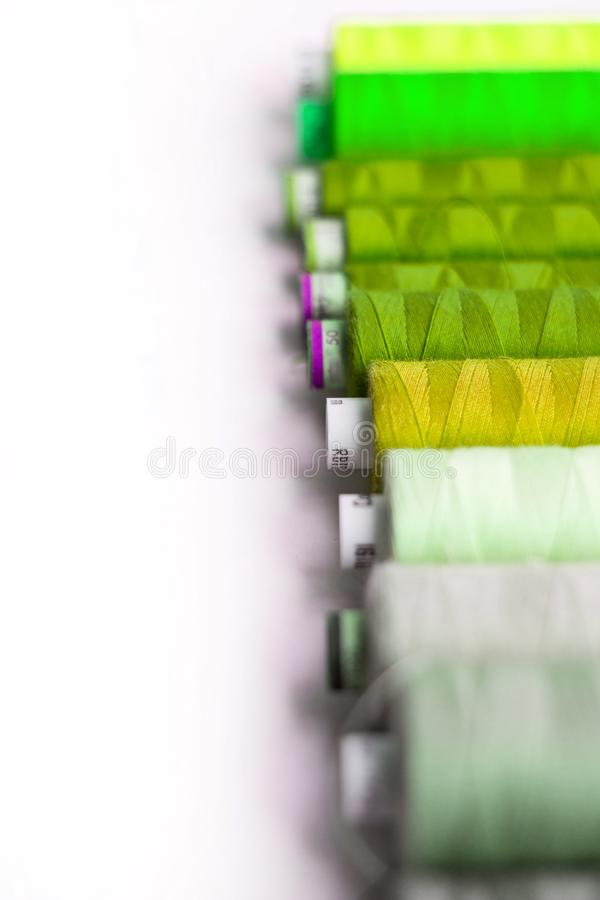 A bunch of sewing thread reels. A closeup photo of colorful sewing thread reels royalty free stock images